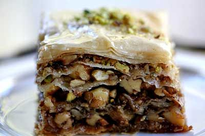 A rich, deliciously sweet pastry made of layers of filo dough filled with chopped nuts and sweetened with syrup or honey.  Possibly Turkic in origin, but there are many stories that can't be verified.  There are many different styles of baklava from different areas like Iran, Azerbaijan, Afghanistan, Armenia, Syria and India.