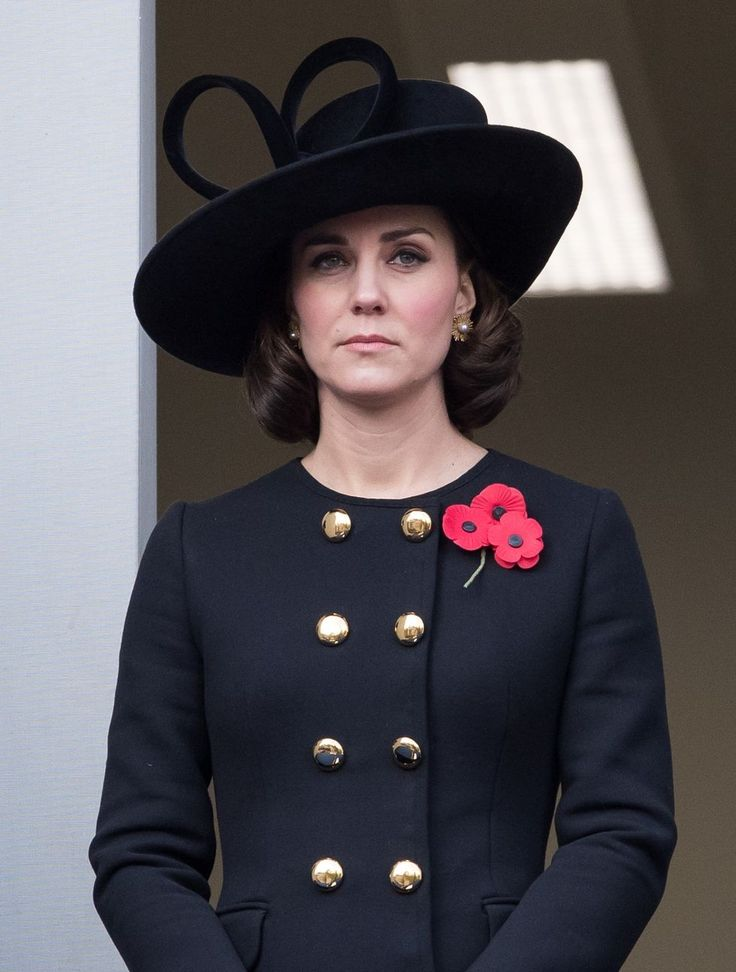 $4,081 On November 12, Kate celebrated Remembrance Sunday in a Dolce & Gabbana coat and carrying an Emmy London clutch.