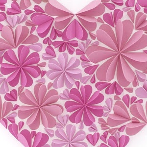 Cut out heart shapes and glue one half in a circular shape to whatever you want to decorate...