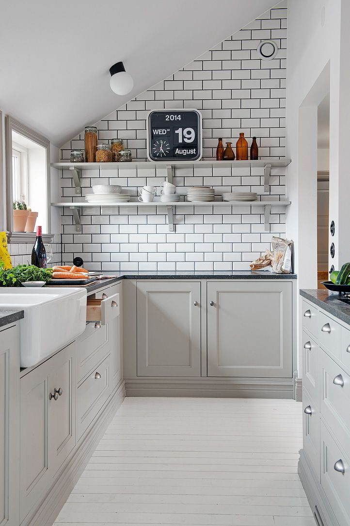 Beautiful and simple kitchen in grey and white. White gloss brick/subway tiles can be found at Mandarin Stone. www.mandarinstone.com