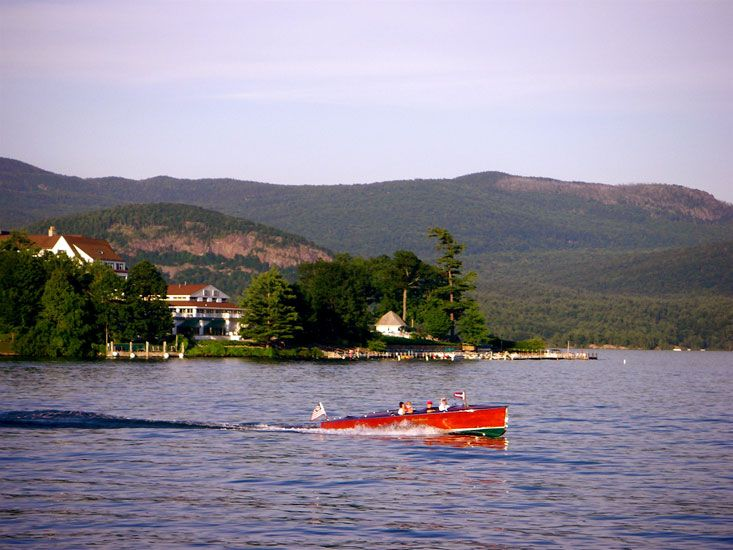 Lake George, NY (must have friend with family cabin on the lake with a great old wood boat!).