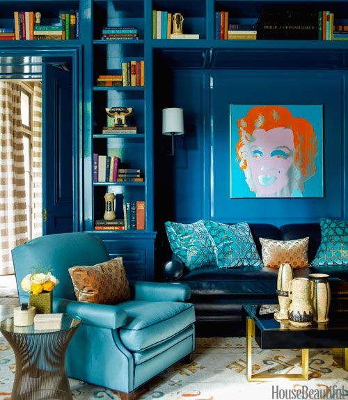 """In the library, the leather sofa and King George club chair were designed by Gambrel and made by Dune. The silkscreen print is by Andy Warhol. Seen through a doorway, the dining room curtains are Cowtan & Tout's Lara Stripe, with the pattern used horizontally """"to make them seem more architectural,"""" says Gambrel. Eric Piasecki  - HouseBeautiful.com"""