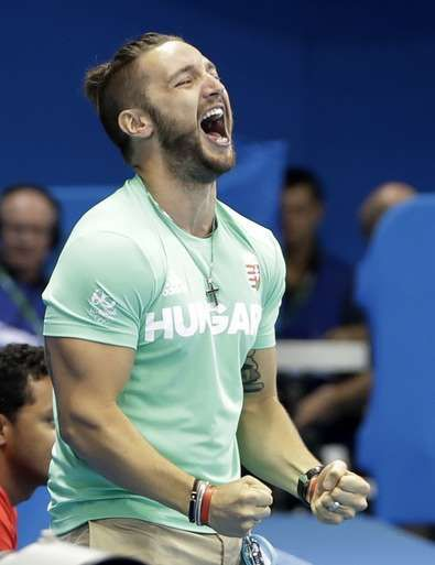 Shane Tusup, the husband of Hungary's Katinka Hosszu, celebrates after she wins the gold medal in the women's 400-meter individual medley during the swimming competitions at the 2016 Summer Olympics, Saturday, Aug. 6, 2016, in Rio de Janeiro, Brazil. (AP Photo/Matt Slocum)