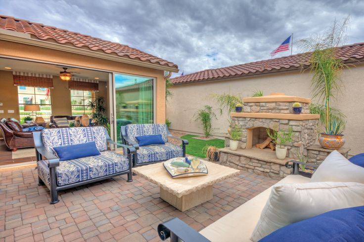 Southwestern inspired outdoor living space connect for Moving glass walls