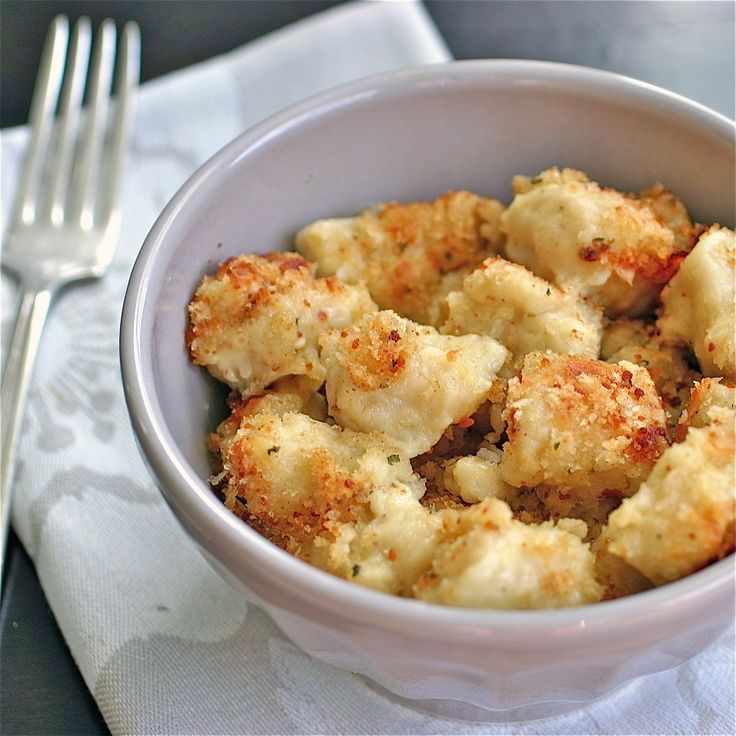Gnocchi Mac 'n Cheese....This is definitely the Cadillac of all mac 'n cheeses – tasty pillows of potato and parmesan gnocchi coated with a creamy, mild cheese sauce and topped with crisp goodness?  Enough said.