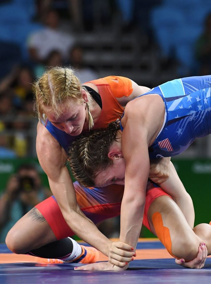 Netherland's Blaszka Jessica (orange) wrestles USA's Augello Haley Ruth (blue) in their women's 48kg qualification match on August 17, 2016, during the wrestling event of the Rio 2016 Olympic Games at the Carioca Arena 2 in Rio de Janeiro. / AFP / Toshifumi KITAMURA