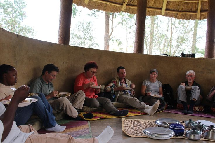 Enjoying a traditional meal after chimpanzee trekking in Kibale forest