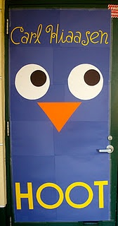 I wonder if we could get Advisory, LA, or reading classes to choose a book they like and recreate the cover on the door.