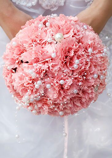 This looks like carnations with pearl picks...I love it!! We could wrap the bottom with lace, it would be beautiful.