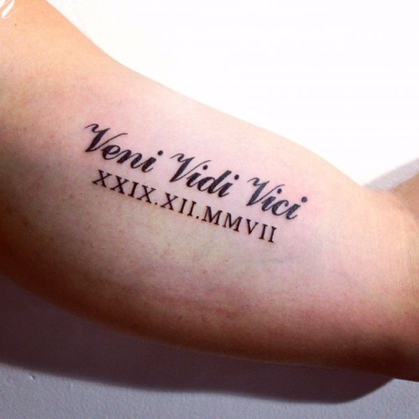 Veni Vidi Vici arm tattoo with roman numerals