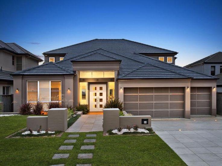 Grey/ blue roof White windows, slightly dark render. (white front door!)