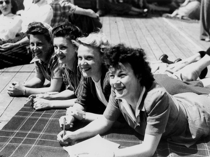 Happy young brides on board a ship bound for their new homes in America, Brisbane, September 1945  Several thousand Australian brides left Brisbane and headed to the United States after the war. Most travelled by sea in groups and were unaccompanied by their husbands.   John Oxley Library, State Library of Queensland Neg: 43466