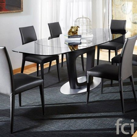 Orbital Design Extending #Table by #Calligaris starting from £4,147. Showroom open 7 days a week. #extendingtables #moderndining  #modernfurniture #furniture_showroom_london #furniture_stores_london #fcilondon #calligaris_extending_tables #round_glass_table