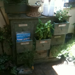 Awesome up-cycle idea with labeled drawers.