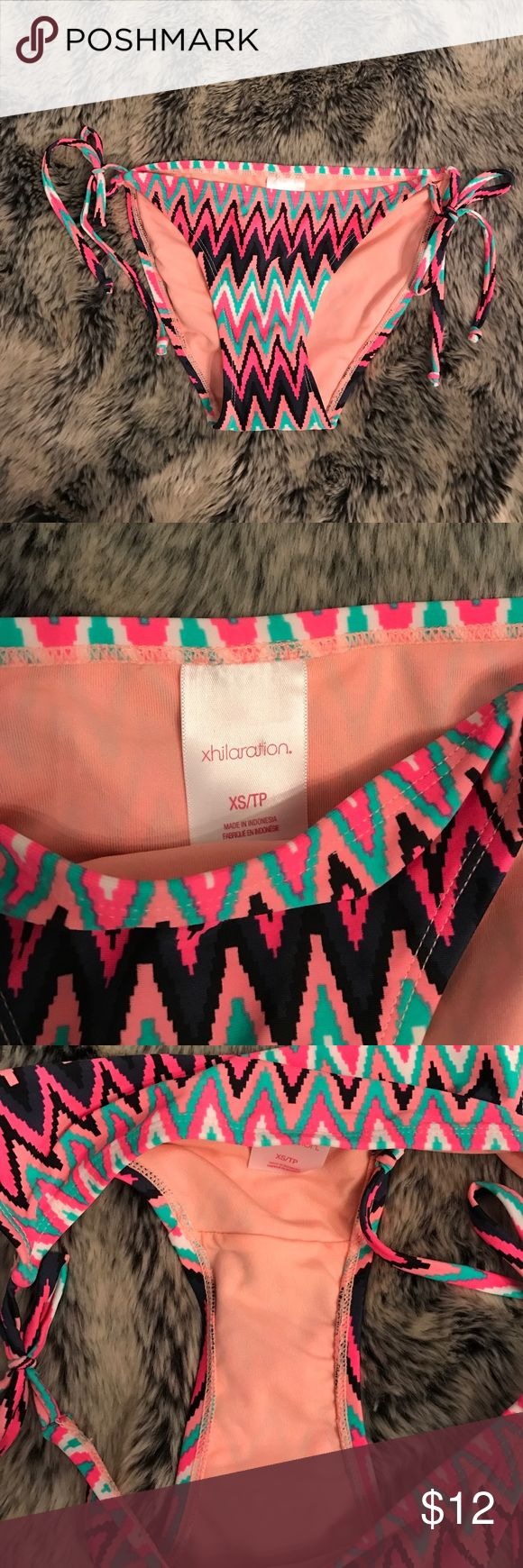 X H I L A R A T I O N NWOT | Chevron bikini bottom | Ties on the sides | Has lots of summery colors including peach, pink, coral, navy blue, aqua, white, etc. | Goes with any plain bikini top! Xhilaration Swim Bikinis