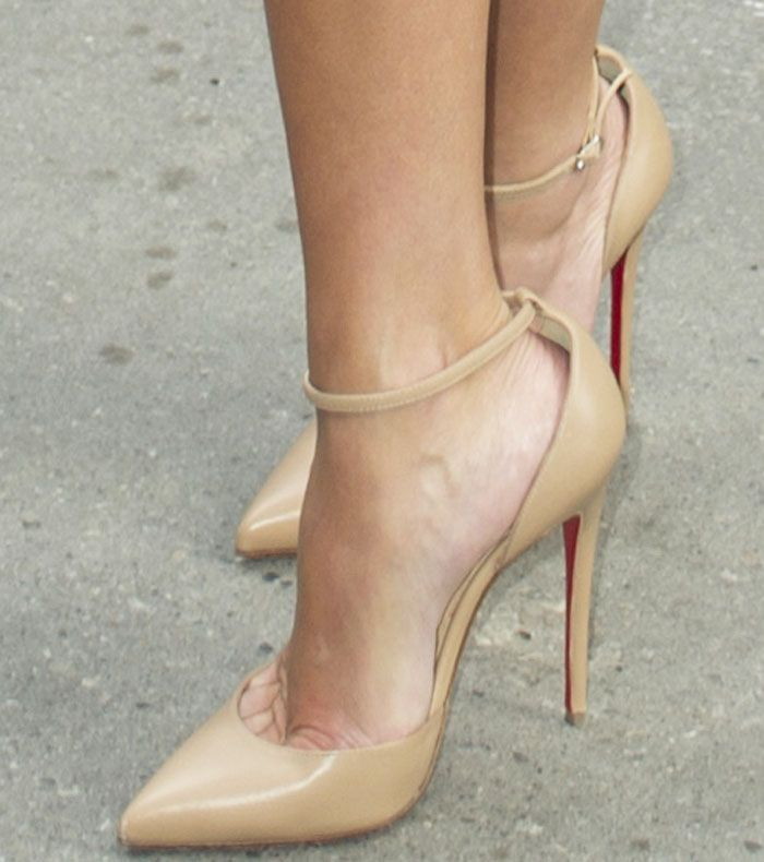 """Reese wore the versatile Christian Louboutin """"Uptown"""" pumps at the Toronto premiere of """"Sing."""""""