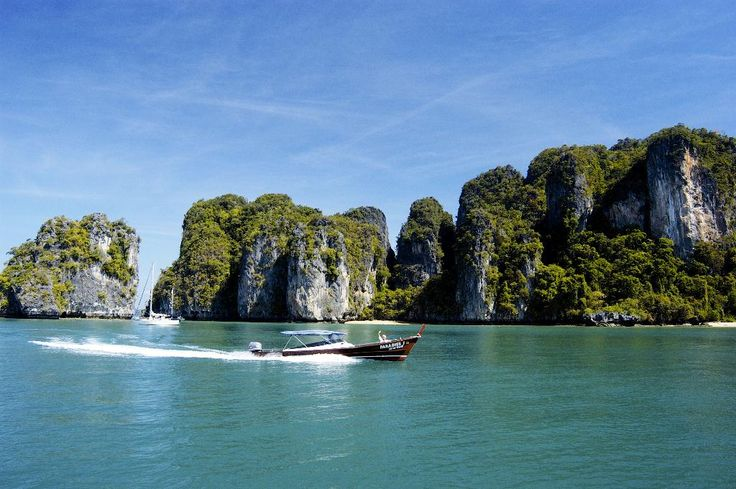 By speedboat or public the transfer from Krabi or Pukhet, the boat trip is really splendid with a clear water, green rocks, white sand beaches and nothing else.
