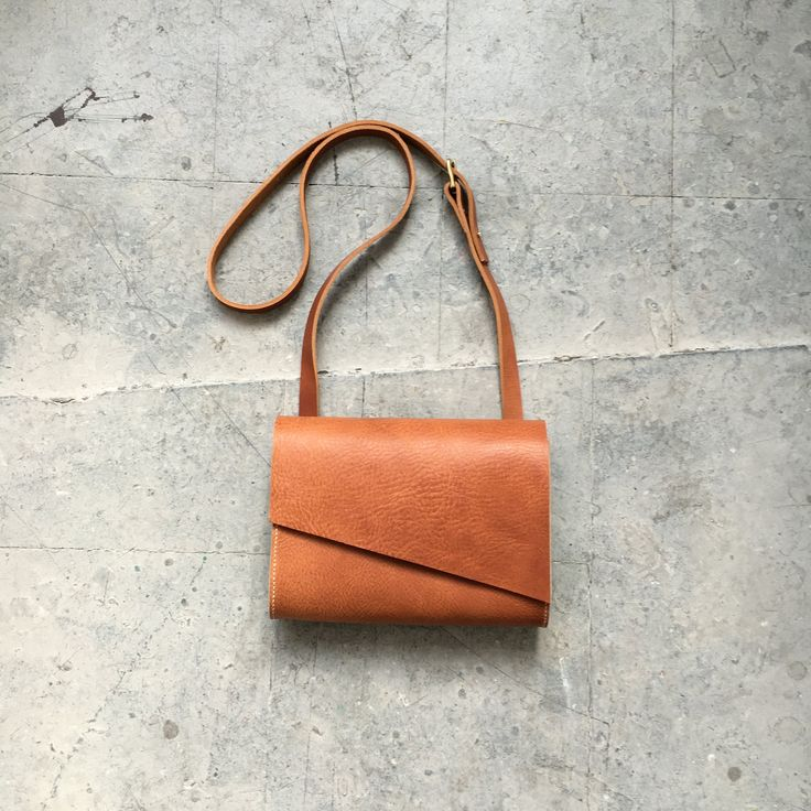 Soft tan crossbody bag now available online