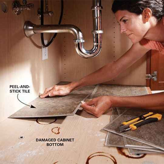Use peel-and-stick tiles to cover up a leaked-on cabinet bottom.                                                                                                                                                                                 More