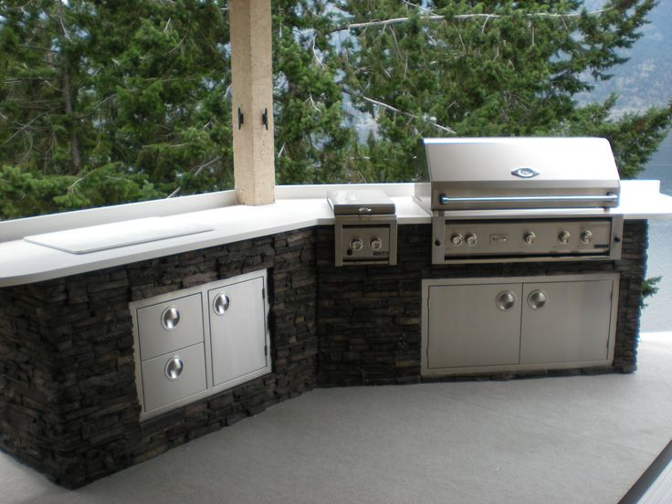 Here is an outdoor kitchen we created for a client in for Cedar outdoor kitchen cabinets