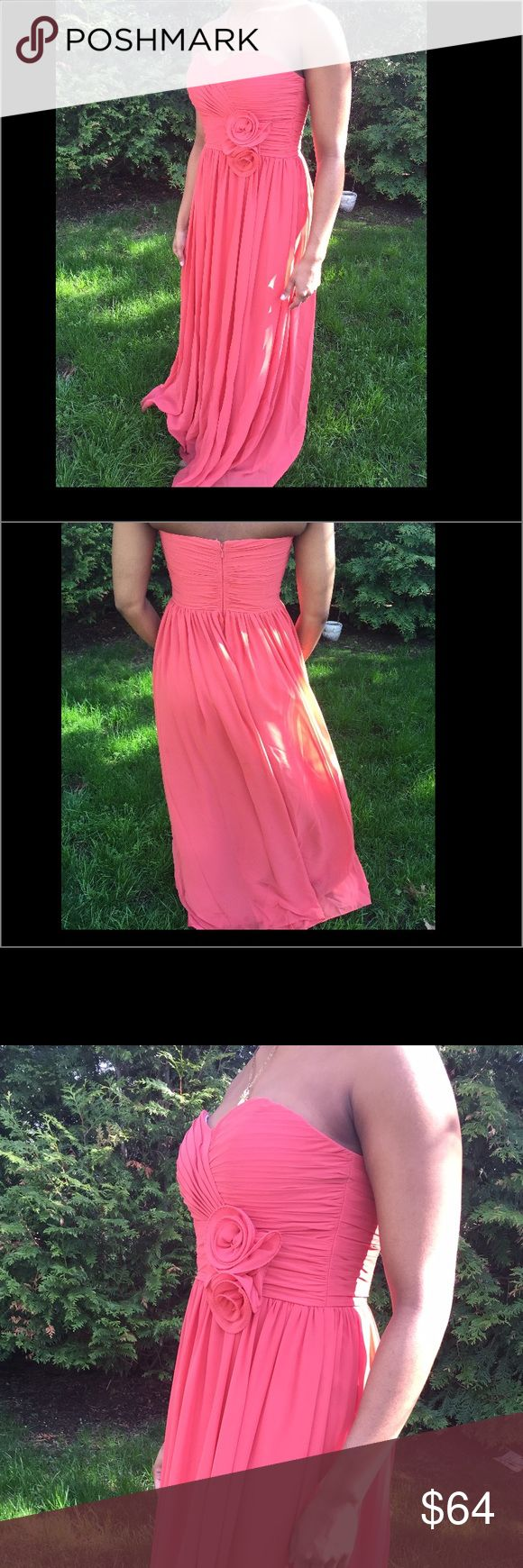 Sweetheart coral pink gown Sweet heart neckline with floral embellishment below the bust. Floor length material that is fully lined and flows. Lovely coral pink shade, perfect pop of color for any event: prom, formal, wedding. Bari Jay Dresses