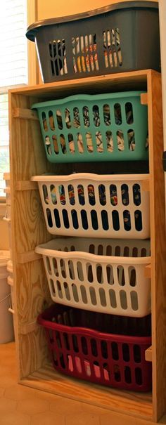 Vertical storage for color coded laundry baskets is a perfect solution for large families.   20 Genius DIY Laundry Room Organization Ideas - DIY for Life