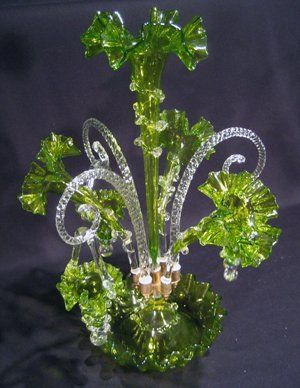 Antique Ornate Vaseline Glass Epergne with central vase, three outer vases and three hanging baskets. All with applied clear rigoree and all with ruffled rims