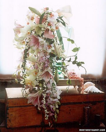 Free form  Pink Wedding Bouquets    Free-form Bouquet    Pink Prominence lilies, amaryllis, green and speckled phalaenopsis orchids, pink dendrobium, dusty pink calla lilies, euphorbia, honeysuckle foliage, and string-of-beads are hand-wired together in this cascading arrangement.