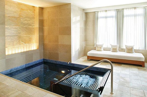 Luxury home spa with neutral colors, likes the tones of warm neutral stone with the ocean blue.