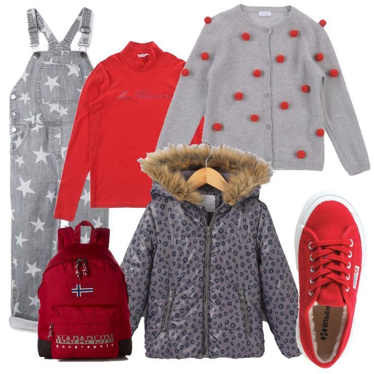 La salopette è un indumento difficile da portare, perfino da bambine. Ma con un buon accostamento, può diventare un modo di vestire semplice e divertente: la salopette è di jeans grigio, con stelle bianche. Una maglietta a maniche lunghe rossa e un maglioncino con dettagli rossi che addolcisce il look. Le scarpe Superga sono rosse con l'interno in pelo, per piedini caldi nonostante il freddo e la pioggia. Un piumino caldo, impermeabile e l'immancabile zainetto fantasia per la scuola.
