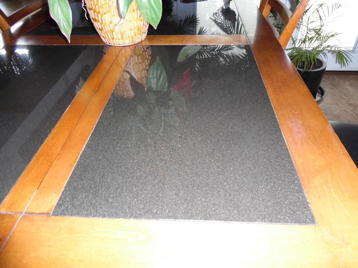 For Sale: INLAY GRANITE TOP PUB TABLE - this table top has four section of granite and also comes with a leaf. The table has four chairs and the table is very heavy.                                                                        REDUCED