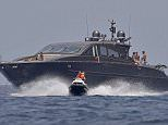 Armed Customs and Excise officers are reported to have boarded Cristiano Ronaldo's holiday yacht as part of an inspection. He is pictured on a yacht on Saturday watching his Spanish model girlfriend Georgina Rodriguez, 23, jetski in Ibiza