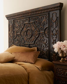 Gorgeous wooden carved headboard.