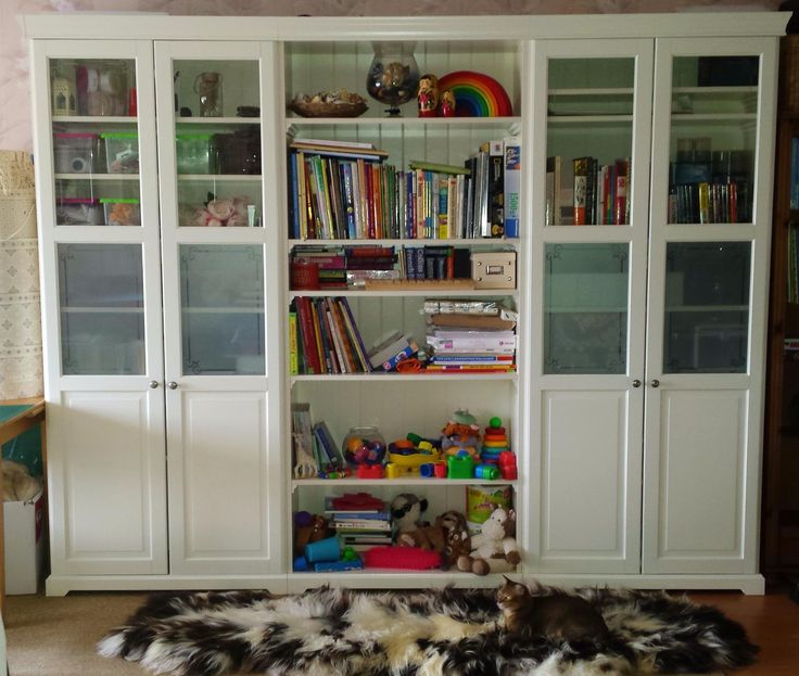 White Liatorp bookcase. Ikea. Glass doors.                                                                                                                                                                                 More