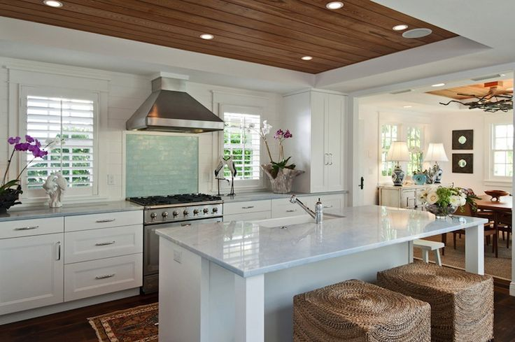The tray style ceiling is paneled with with wood paneling and features recessed lighting and built-in speakers.