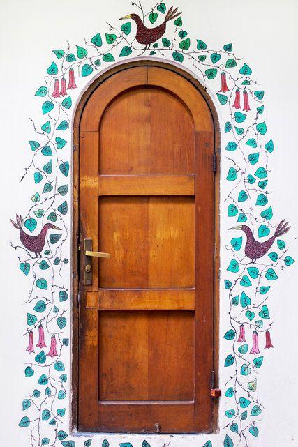 Birds and vines wind around the arched door of La Chascona, Pablo Neruda's home in Santiago, Chile. Credit Danielle Villasana