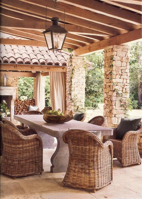 beautiful outdoor room with fireplace and stone columns