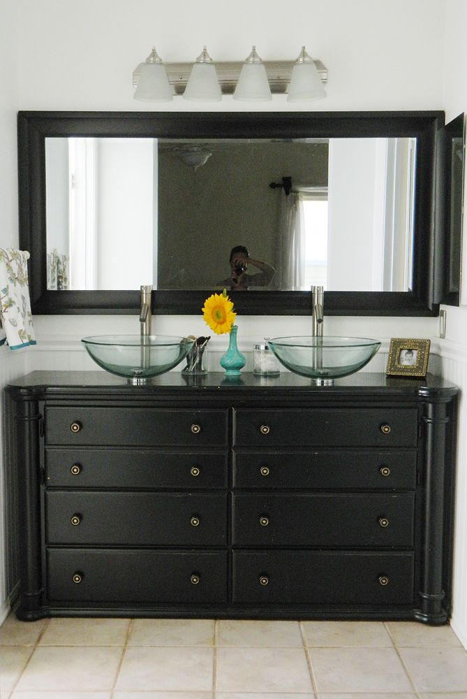 Repurposed dresser as bathroom vanity with lots of pictures.  This one has the sinks on top instead cutting into the top of the dresser.