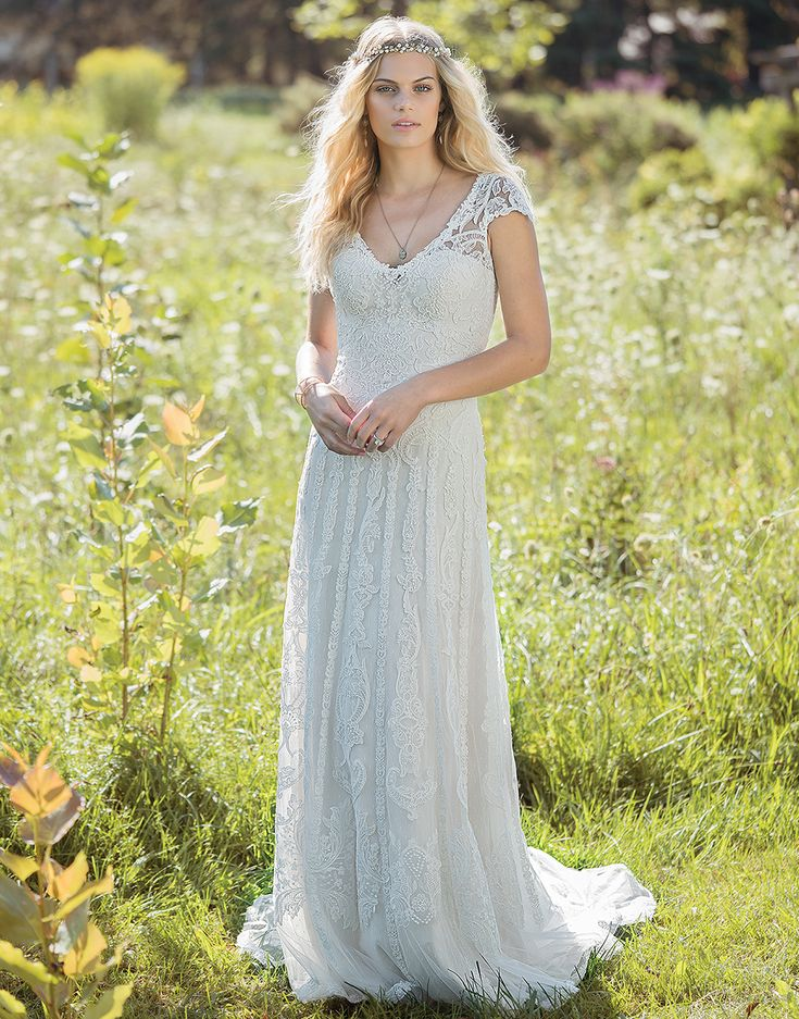 Lillian West 6482 Ivory/Ivory Size 12 Corded lace adorns this soft V-neck gown with illusion straps and cap sleeves. Jersey lining means added comfort for the carefree bride, no matter where the setting is for her dream wedding. https://www.lillianwest.com/lillian_west/6482