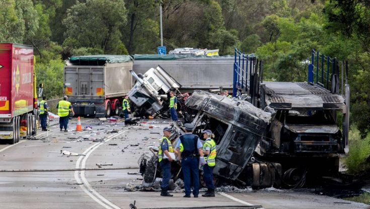 Two truck drivers died in a fiery head-on collision after one veered onto the wrong side of Picton Road on Friday morning.