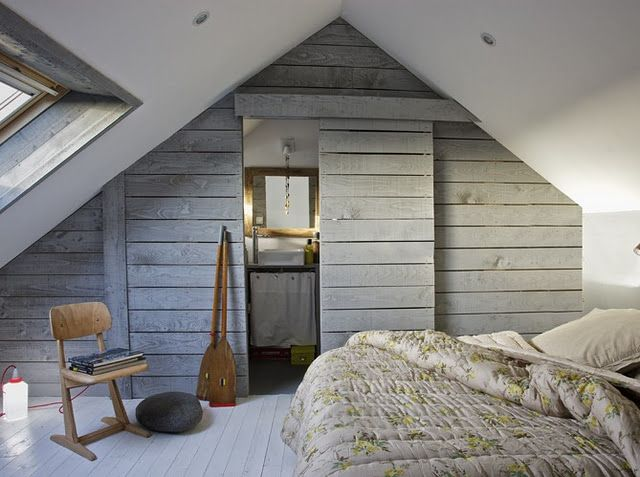 like the idea of a sliding door to the bathroom. love the idea of having it blend in with the wall boards.