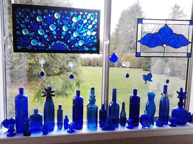 I pinned a picture of blue glass in a window and over 200 people have re-pinned it. So I thought I would pin this picture of my own window for all the blue glass lovers!
