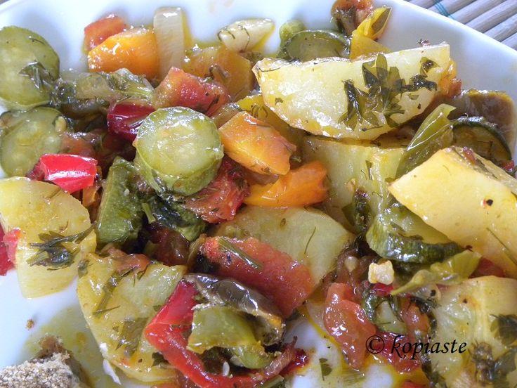 Briam  http://kopiaste.org/2008/01/briam/    A delicious Greek vegan dish with vegetables.  Μπριάμ  http://www.kopiaste.info/?p=229