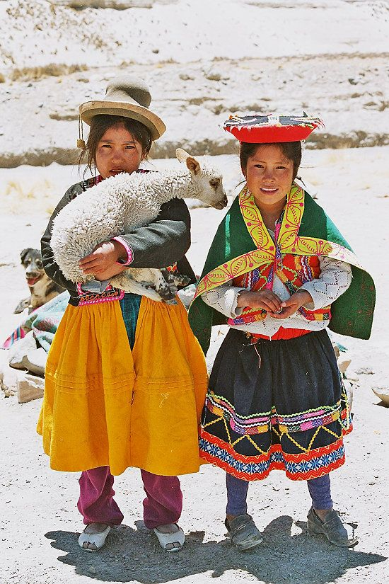 Peruvian girls. It's amazing how many people still dress this way, I LOVE the culture in Peru. :)