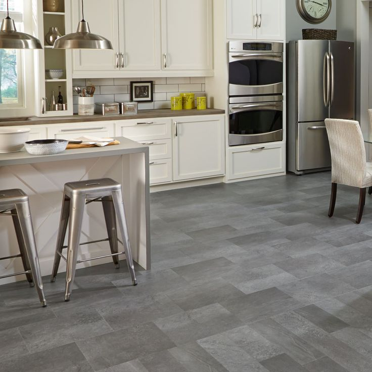 Mannington's Adura® Meridian luxuvy vinyl tile delivers the look of weathered concrete in an easy care way.