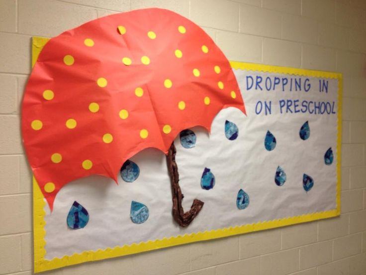 Rain/umbrella bulletin board. The kids tore tissue paper in shades of blue to make the raindrops
