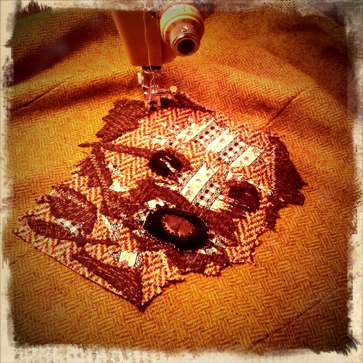 Applique portrait of Stella the Border Terrier #applique #sewing #art #tweed #dog
