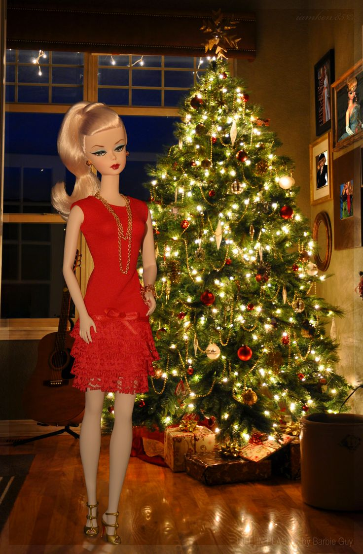"""All I want for Christmas is… In this photo: Debut™ Barbie® Doll wearing the festive """"most wanted"""" dress by Marcelo Jacob with Christian Louboutin Barbie® heels."""
