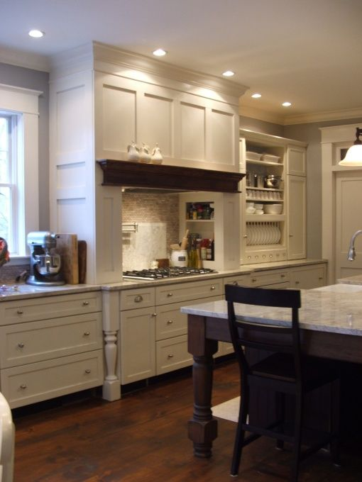 Creamy White Shaker Style Cabinets With Turned Legs And