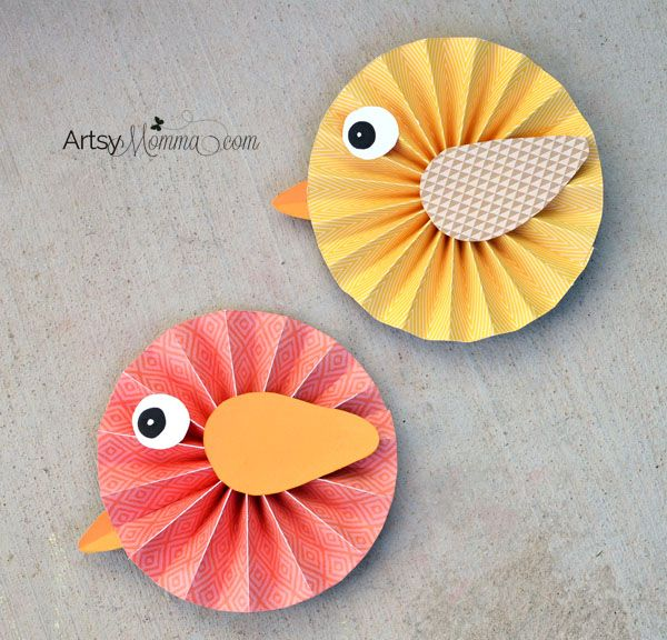 How to make Paper Rosette Birds to use as a cheerful spring decoration.This bird craft includes a photo tutorial so you can make them too!